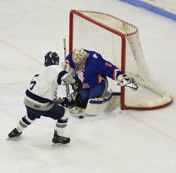 Chris Romano drives net against Skowhegan