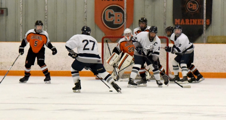 Senior Captain Noah Grondin battles in front of the net